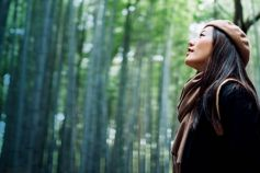 Asian girl in bamboo forest