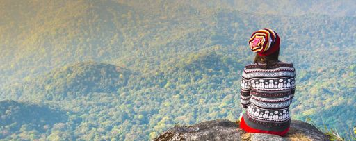 Girl on to top of a mountain