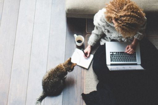 Girl sitting on floor working from home
