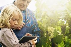 girl using tablet with farmer