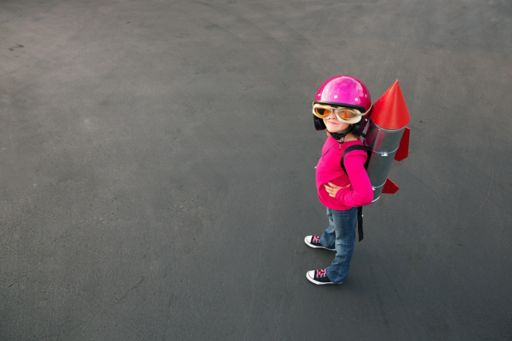 girl wearing a pink helmet