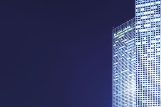 glass-building-with-white-lights-at-night-view