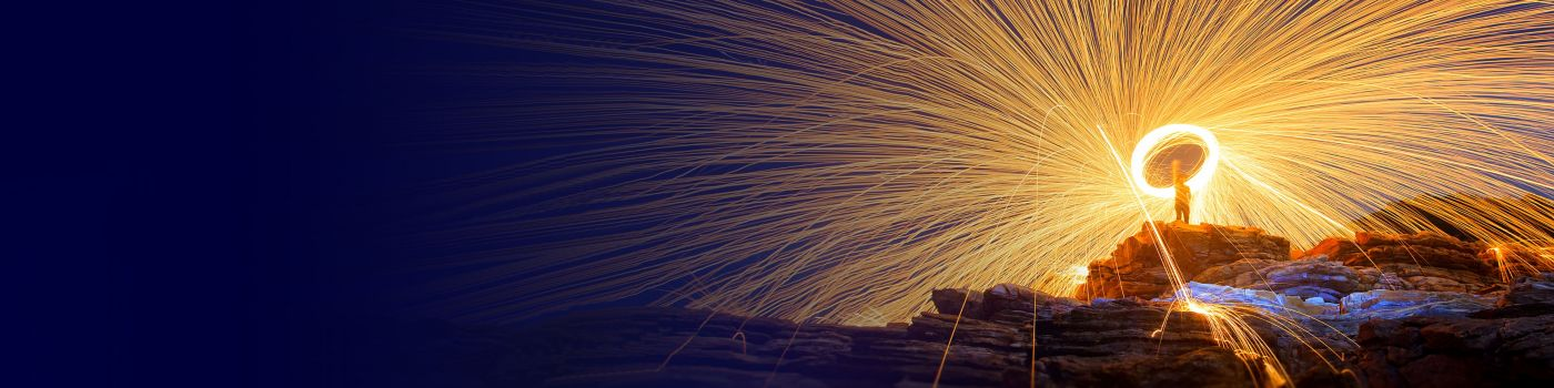 Illuminated rays coming from spinning steel wool