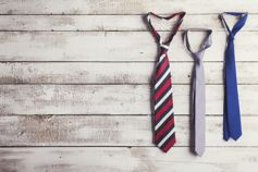 Ties hanging from wooden wall