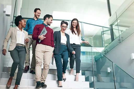 Group of business people walking down stairs
