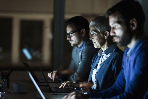 Businesspeople looking at computer screens