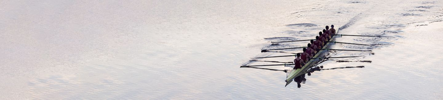 Group of men rowing boat