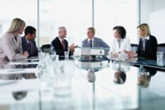 Group of office workers in a boardroom meeting