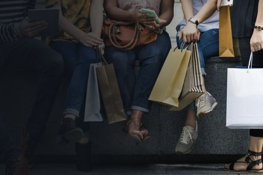 Group of women holding shopping bags