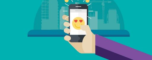 Hand holding a smartphone showing heart eyes emojis and city skyline