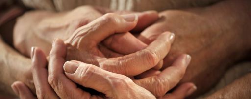 Hands holding each other