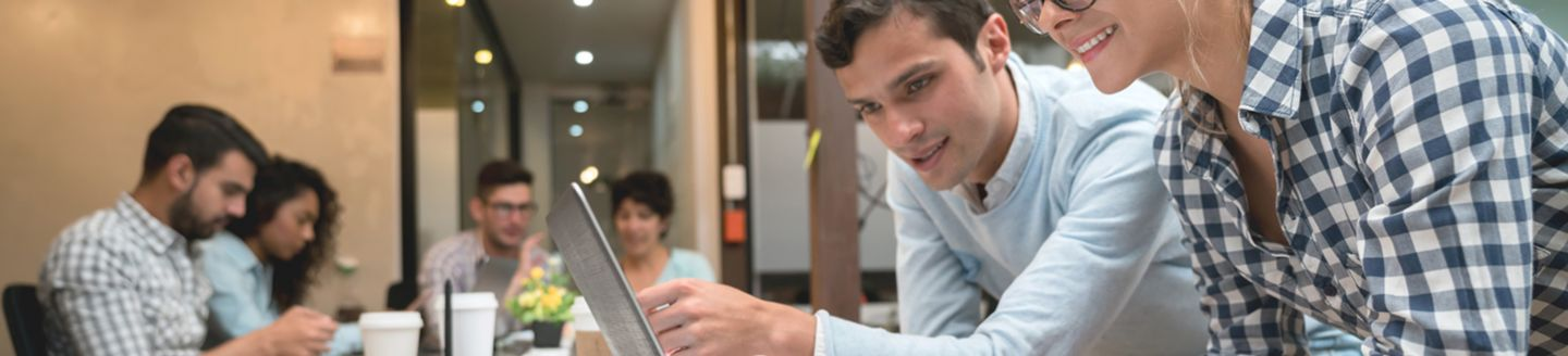 Happy office workers using technology