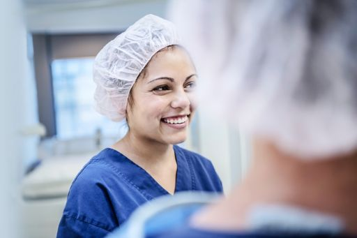 young female surgeon in hospital smiling
