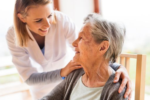 Healthcare professional and a senior woman during a home visit