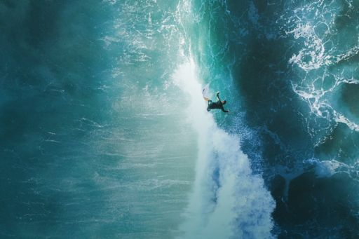 Overhead view of man surfing