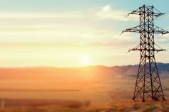 High voltage tower in mountains at sunset