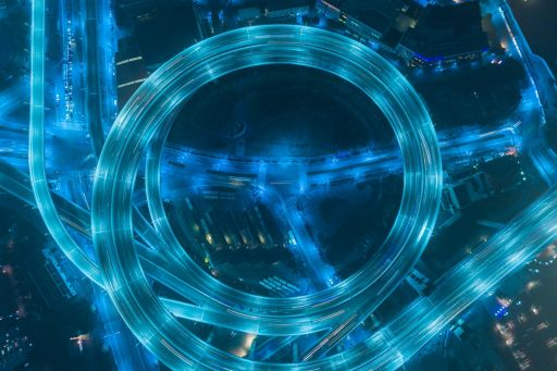 light blue and blue highway at night as a symbol for Transfer Pricing Services