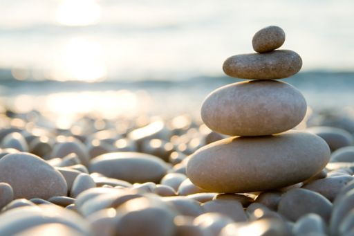 rocks balanced on top of each other by the ocean