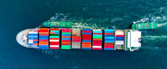 Aerial view of boat carrying shipping containers