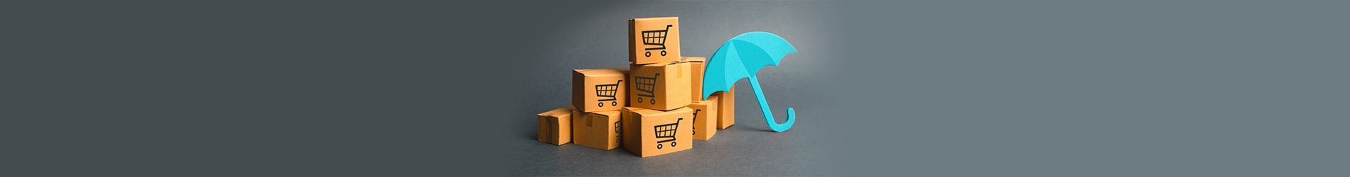 Blue umbrella leaning against wooden blocks with icons of shopping  trollies on them