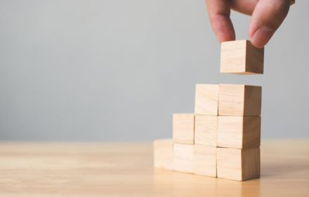 Hand stacking wooden blocks