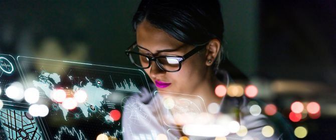businesswoman looking at futuristic interface screen