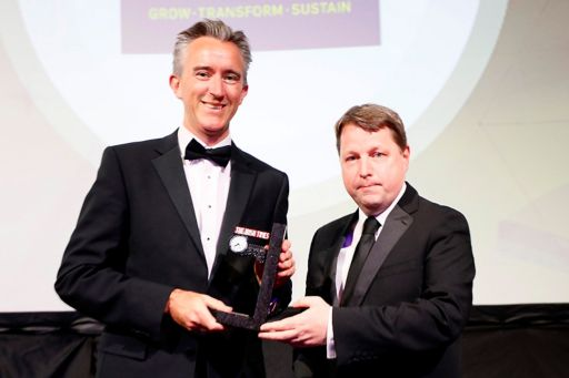 Ciarán Hancock (right), Business Editor at The Irish Times, presents the Deal of the Year award to outgoing Coillte chief executive Fergal Leamy.