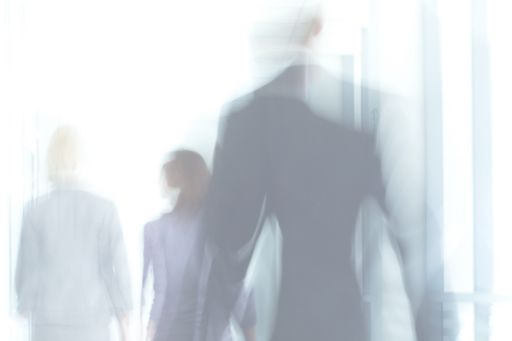 Blurry figures disappearing into distance