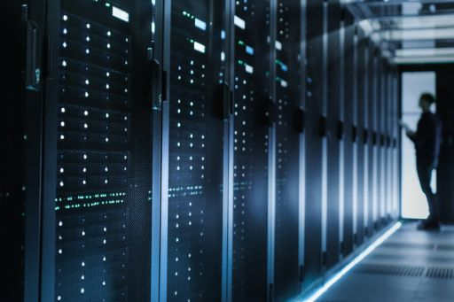 Man standing in front of a row of servers
