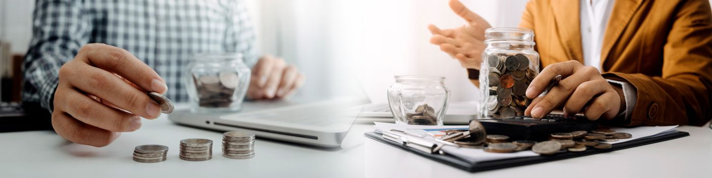 Two colleagues in meeting with jars of coins