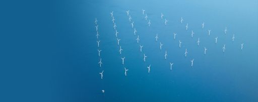 Offshore wind farm, aerial shot of wind turbines at sea