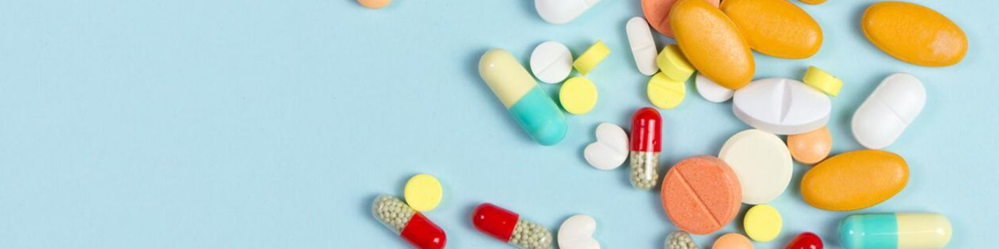 Selection of pills on blue background