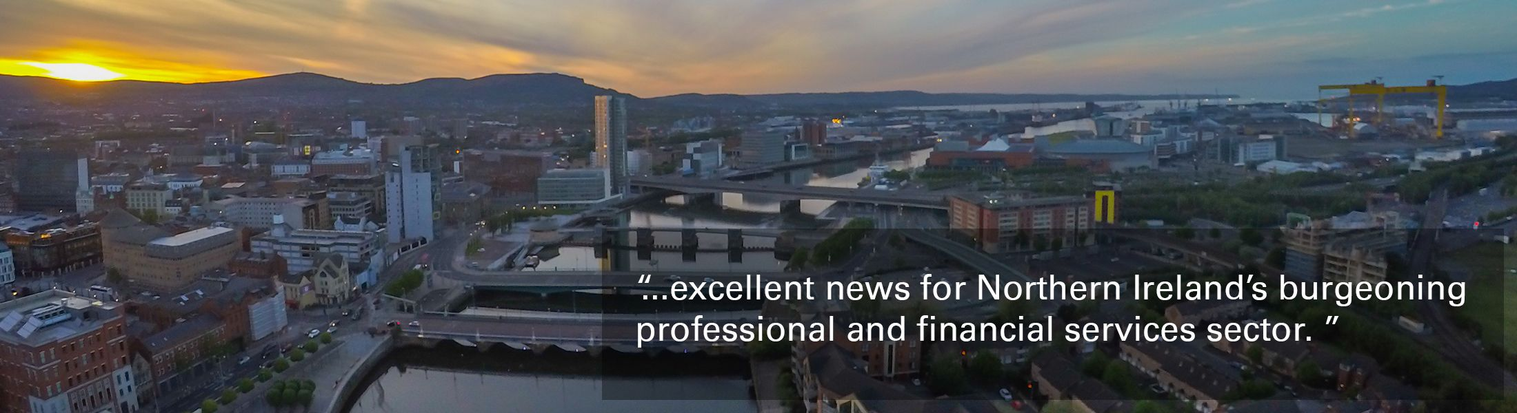 """Image of Belfast city at sunset with text overlaid """"excellent news for Northern Ireland's burgeoning professional and financial services sector."""""""