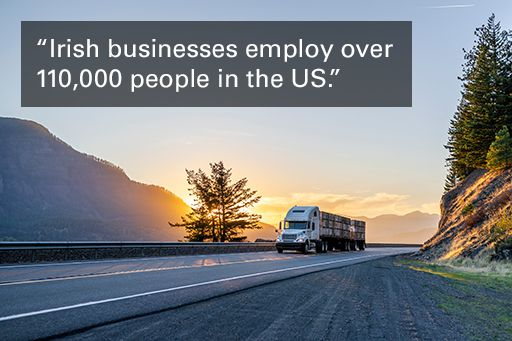 """Image of truck on freeway with text overlaid, """"Irish businesses employ over 110,000 people in the US."""""""