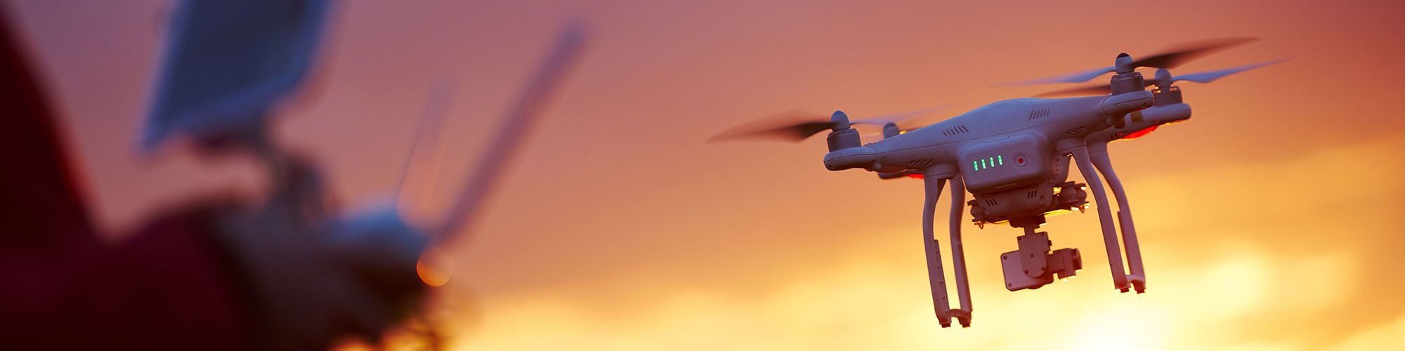 Drone in flight against sunset background