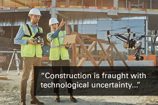 """2 engineers in hard hats looking at drone with quote overlaid: """"construction is fraught with technological uncertainty"""""""