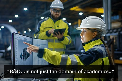 """Two engineers in a factory looking at a graph on-screen with quote overlaid """"R&D…. is not just the domain of academics"""""""