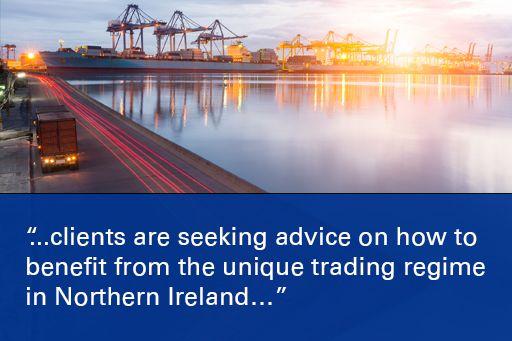 """Image of Belfast City Hall with quote overlaid """"Unfettered access to the GB market from Northern Ireland, combined with the continuation of tariff free trading with the EU...does bring potential benefits."""""""