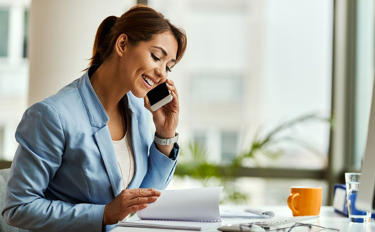 Smiling businesswoman making phone call