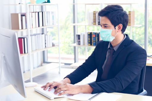 People working in an office and wearing masks