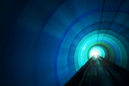 Illuminated train tunnel blue green