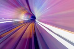 Illuminated train tunnel purple