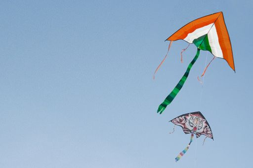 Colourful Indian kites flying in a blue sky