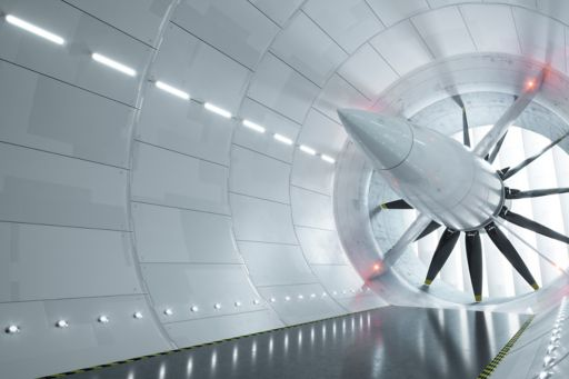 Inside view of a manufacturing plant with big white rotating fans