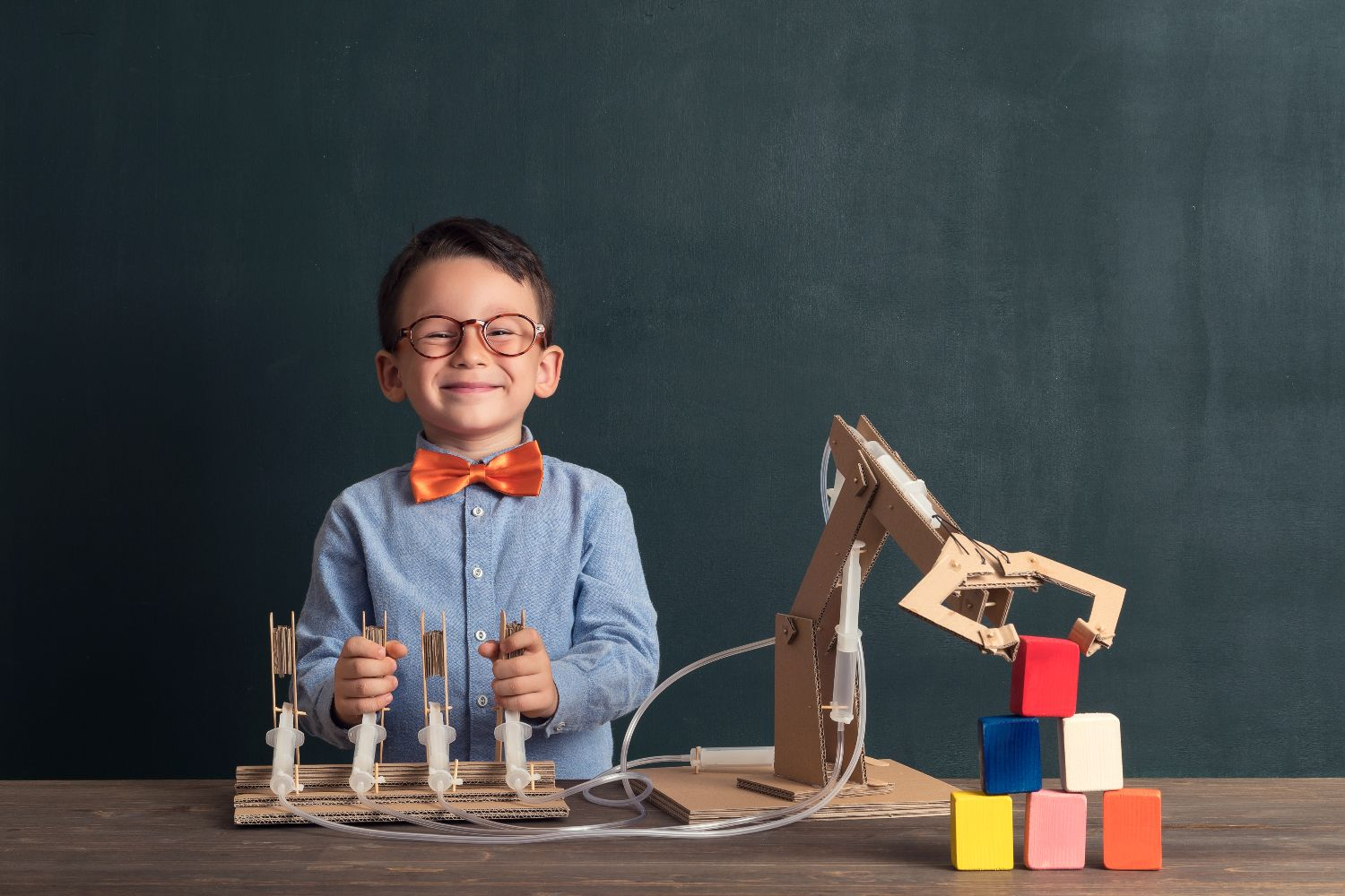 kid playing with science experiment