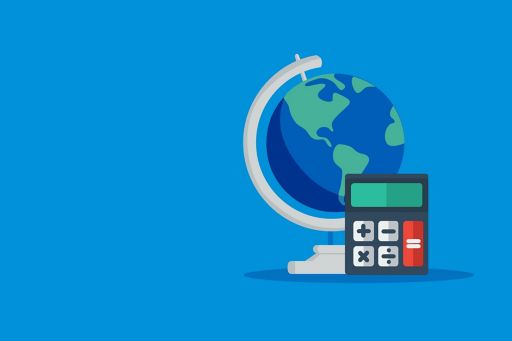 Globe and calculator on light blue background