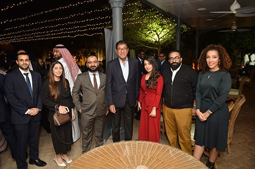 KPMG Bahrain managing partner with some guests during the alumni reception event