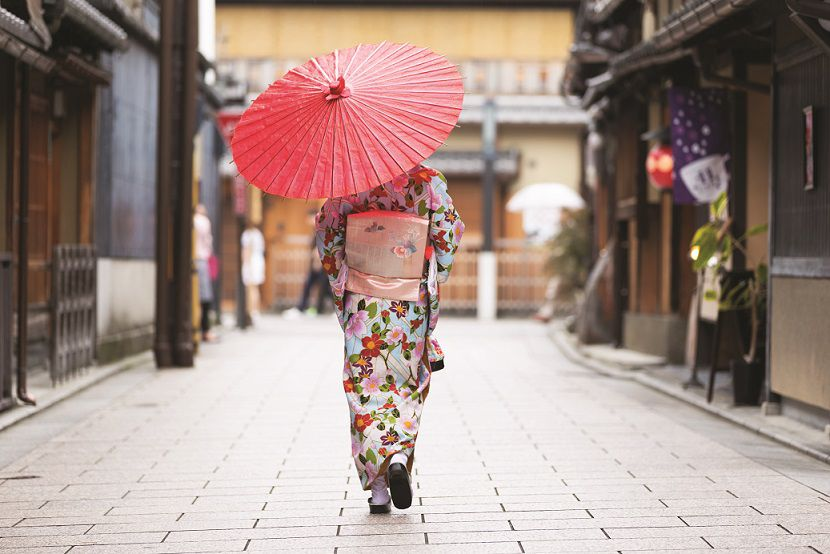 Japanese woman walking with traditional umbrella