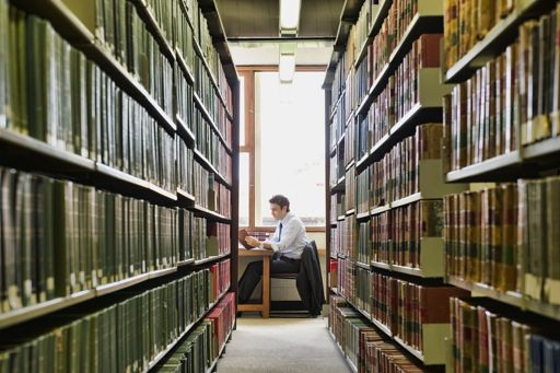 man studying in a library