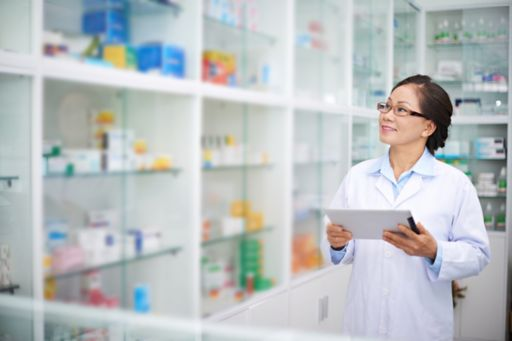 lady holding ipad in a pharmacy